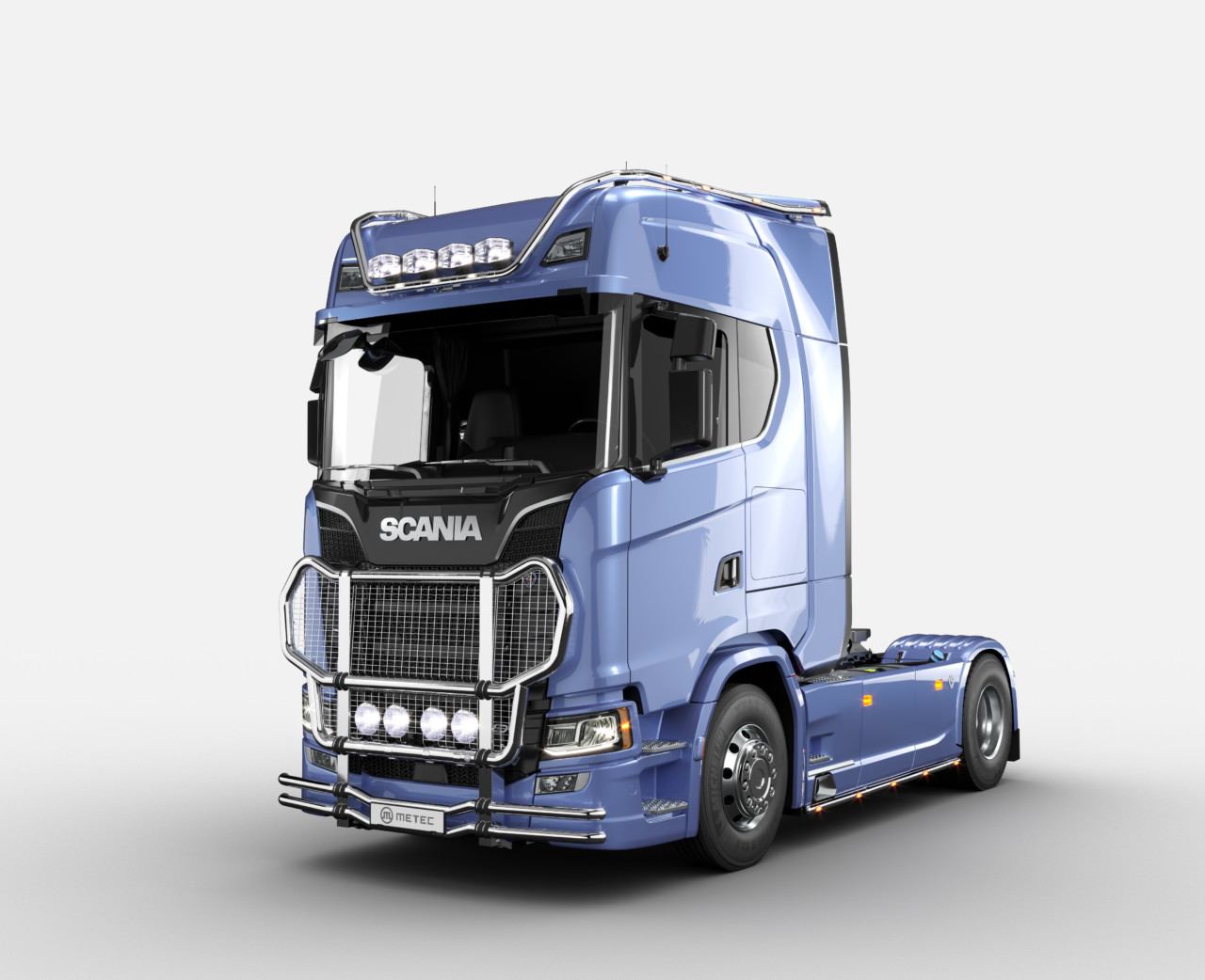 Blue Scania truck with added Metec accessories for road safety.